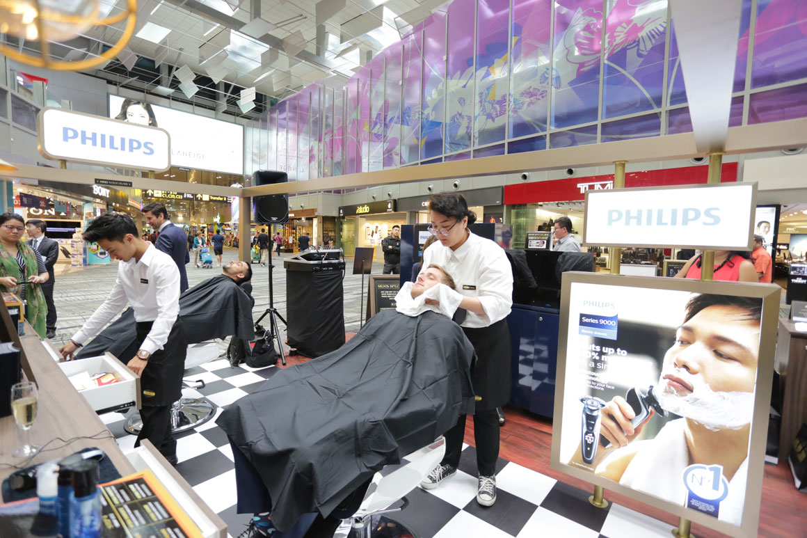 Why did L'Oreal Collaborate with Philips to Launch a Male Grooming Outlet at Changi Airport?